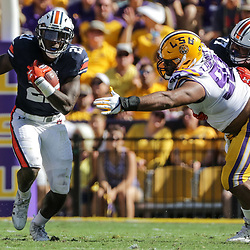 Oct 14, 2017; Baton Rouge, LA, USA; Auburn Tigers running back Kerryon Johnson (21) runs past LSU Tigers defensive end Rashard Lawrence (90) during the first half of a game at Tiger Stadium. Mandatory Credit: Derick E. Hingle-USA TODAY Sports