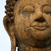 Buddha face at Wat Mahathat in Sukhothai. The Sukhothai kingdom was an early Thai kingdom in north central Thailand. It existed from during the 13, 14, 15th centuries The.old capital is in ruins and is a Historical Park..View from Feb, 2007.