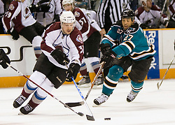 April 16, 2010; San Jose, CA, USA; Colorado Avalanche center Kevin Porter (left) fights for the puck with San Jose Sharks center Manny Malhotra (27) during the first period of game two in the first round of the 2010 Stanley Cup Playoffs at HP Pavilion.  The Sharks defeated the Avalanche 6-5 in overtime. Mandatory Credit: Jason O. Watson / US PRESSWIRE