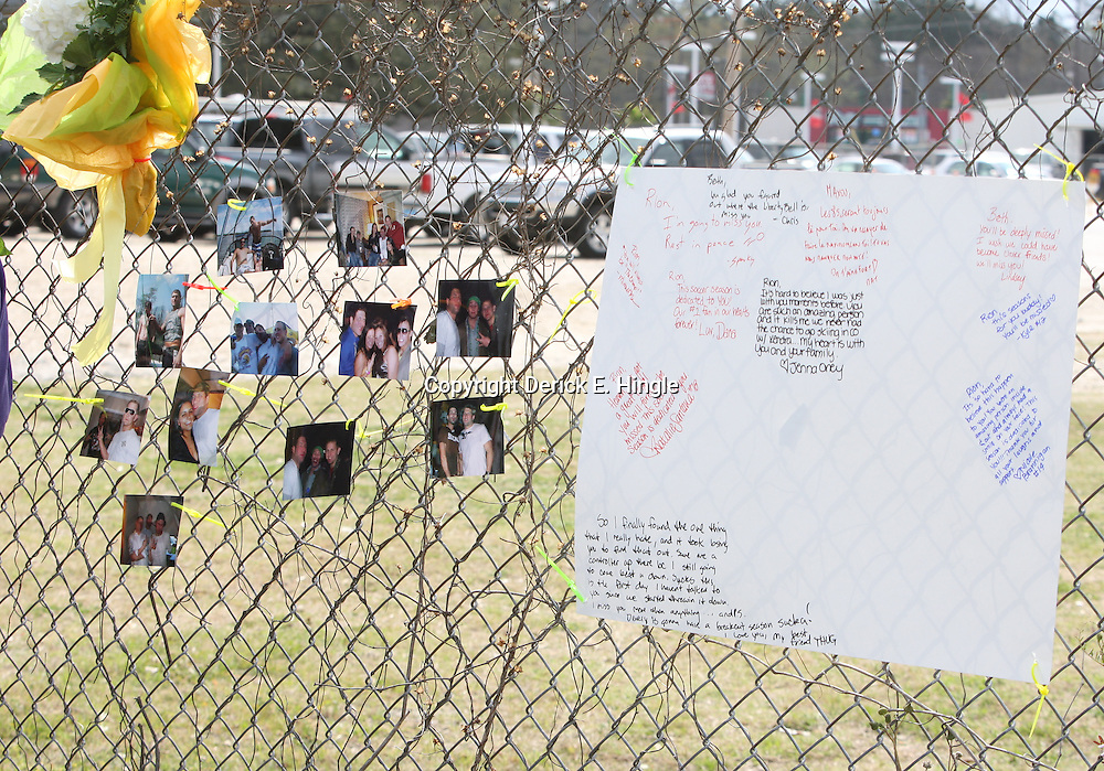 (Shot on March 6, 2009) Friends attached photos to the fence in memory of fellow students that were killed while walking home shortly after 2:00am on the morning of March 6, 2008 on Nashville Street in Hammond, Louisiana after a drunk driver hit five students killing three and critically injuring one and leaving one student with minor injuries, the driver identified as 21-year-old Derek Quebedeaux also a Southeastern student was arrested by Hammond Police.. (Photo by: Derick Hingle)