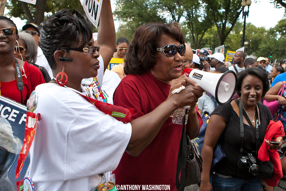 A woman sings into a megaphone as she walks to the Martin Luther King Jr. Memorial during the 50th Anniversary of the March on Washington on Saturday, August 24, 2013 in Washington, DC.