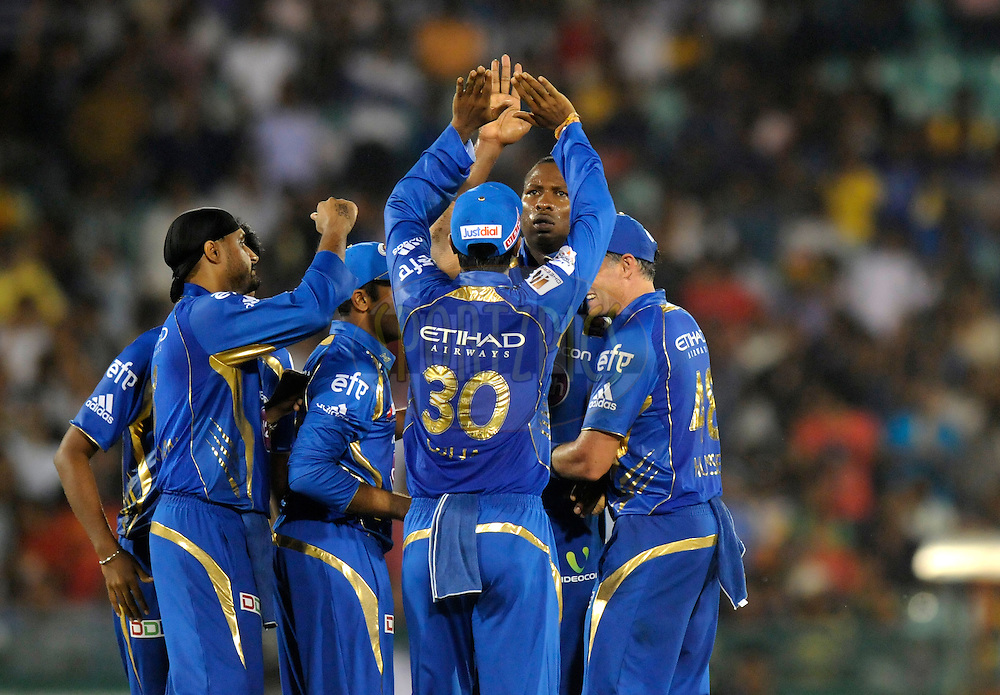 Kieron Pollard captain of Mumbai Indians  celebrates the wicket of Mohammad Hafeez captain of Lahore Lions during the qualifier 2 match of the Oppo Champions League Twenty20 between the Mumbai Indians and the Lahore Lions held at the Chhattisgarh International Cricket Stadium, Raipur, India on the 13th September 2014<br /> <br /> Photo by:  Pal Pillai / Sportzpics/ CLT20<br /> <br /> <br /> Image use is subject to the terms and conditions as laid out by the BCCI/ CLT20.  The terms and conditions can be downloaded here:<br /> <br /> <br /> http://sportzpics.photoshelter.com/gallery/CLT20-Image-Terms-and-Conditions-2014/G0000IfNJn535VPU/C0000QhhKadWcjYs
