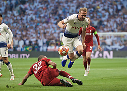 MADRID, SPAIN - SATURDAY, JUNE 1, 2019: Tottenham Hotspur's Harry Kane dives over a tackle from Liverpool's Joel Matip during the UEFA Champions League Final match between Tottenham Hotspur FC and Liverpool FC at the Estadio Metropolitano. (Pic by David Rawcliffe/Propaganda)
