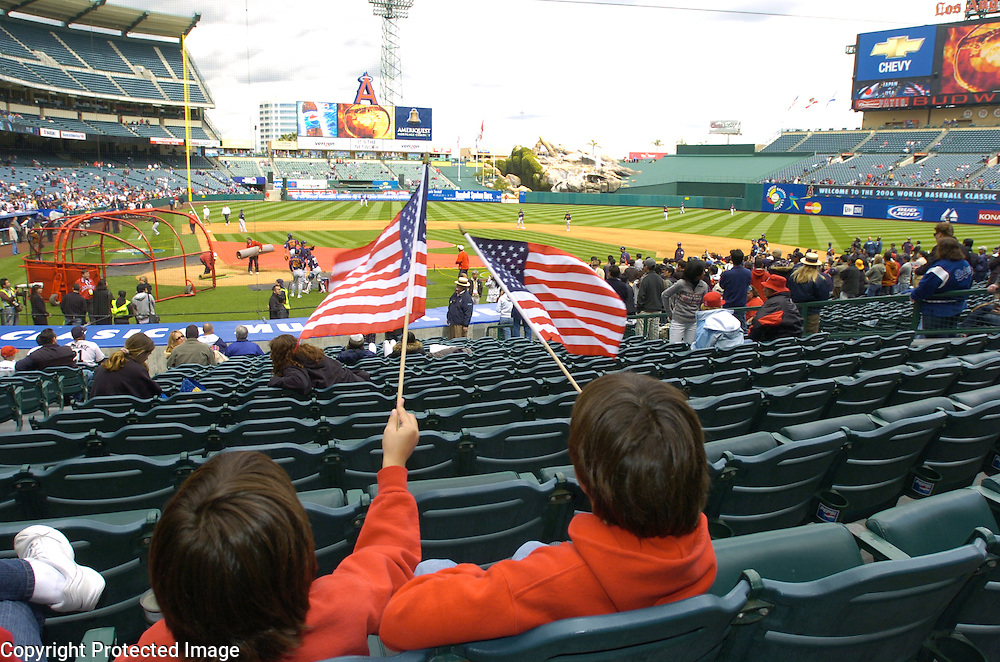 Team USA fans wave the American Flag during pregame warmups before the start of Round 2 action at Angel Stadium of Anaheim.