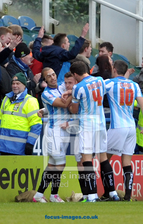Harry Bunn (centre) of Huddersfield Town is congratulated on his equaliser against Leeds United during the Sky Bet Championship match at the John Smiths Stadium, Huddersfield<br /> Picture by Graham Crowther/Focus Images Ltd +44 7763 140036<br /> 31/01/2015
