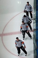 KELOWNA, CANADA - NOVEMBER 3:  Pat Smith and Nick Swaine, referees and Kris Hartley and Mike Langin, linesman, stand on the ice during the national anthem as the Prince George Cougars visit the Kelowna Rockets on November 3, 2012 at Prospera Place in Kelowna, British Columbia, Canada (Photo by Marissa Baecker/Shoot the Breeze) *** Local Caption ***