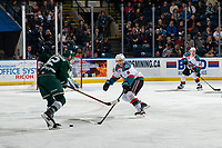 KELOWNA, CANADA - FEBRUARY 15: Max Patterson #12 of the Everett Silvertips is stick checked by Kaedan Korczak #6 of the Kelowna Rockets during second period on February 15, 2019 at Prospera Place in Kelowna, British Columbia, Canada.  (Photo by Marissa Baecker/Shoot the Breeze)
