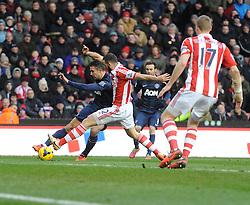 Manchester United's Robin van Persie looks to cross the ball. - Photo mandatory by-line: Alex James/JMP - Tel: Mobile: 07966 386802 01/02/2014 - SPORT - FOOTBALL - Britannia Stadium - Stoke-On-Trent - Stoke v Manchester United - Barclays Premier League