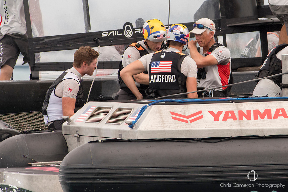 The Great Sound, Bermuda, 24th June 2017, Oracle Team USA's Tom Slingsby, Jimmy Spihill, Kyle Langford and coach Phillip Presti huddle after losing race five to Emirates Team New Zealand. Day three of racing in the America's Cup presented by louis Vuitton.
