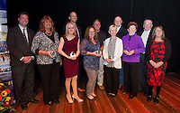 WMUR Meteorologist Kevin Skarupa, Christine Harris winner of J Bart Conners Award, Sophia Joyal winner of Student Leader Award, Christopher Walkley winner of the Young Professional Award, Chuck and Lisa Drew winners of the Public Service Award, Beverly and Jeff Brewer winners of the Hurst Award, Mariam and Bob Smith winners of the James R. Irwin Sr. Award and LR Chamber of Commerce Executive Director Karmen Gifford on stage following the 2015 Community Hero Awards at the Winnipesaukee Playhouse on Tuesday evening.  (Karen Bobotas/for the Laconia Daily Sun)