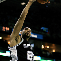 Mar 01, 2010; New Orleans, LA, USA; San Antonio Spurs center Tim Duncan (21) dunks against the New Orleans Hornets during the first half at the New Orleans Arena. Mandatory Credit: Derick E. Hingle-US PRESSWIRE