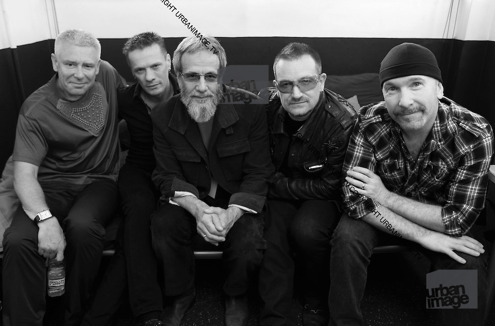Adam Clayton, Larry Mullen, Yusuf Islam (Cat Stevens), Bono and The Edge (U2) backstage Island 50 concerts Hammersmith Empire - London 2009