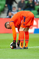 Perth Glory goalkeeper Liam Reddy (33) prepares for goal kick at the Hyundai A-League Round 2 soccer match between Melbourne Victory and Perth Glory at AAMI Park in Melbourne.