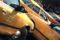 Several taxi cabs on Lafayette St. in New York City.