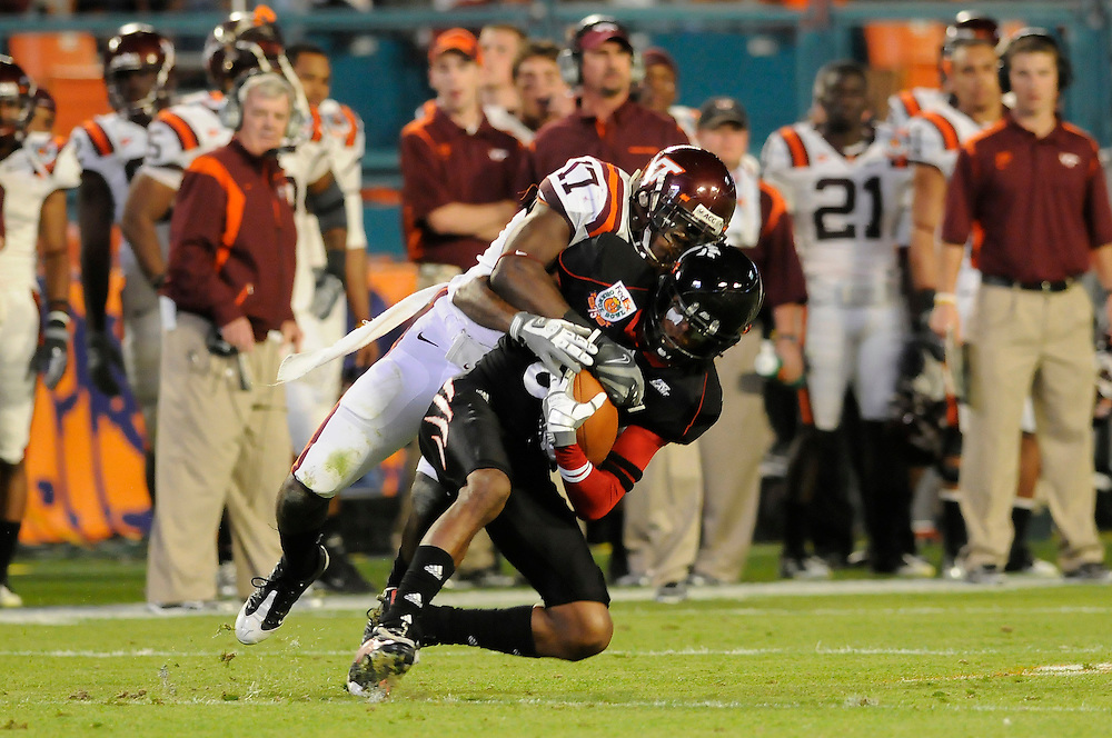 January 1, 2009: Marcus Barnett of the Cincinnati Bearcats is tackled by Kam Chancellor of the Virginia Tech Hokies during the NCAA football game between the Virginia Tech Hokies and the Cincinnati Bearcats in the Orange Bowl Classic. The Hokies defeated the Bearcats 20-7.