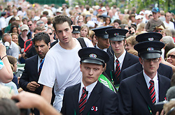 LONDON, ENGLAND - Thursday, June 24, 2010: John Isner (USA) is escorted through the crowds after the historic longert game ever that lasted 11 hours and five minutes over three days with the final score 6-4 3-6 6-7 (7-9) 7-6 (7-3) 70-68 on day four of the Wimbledon Lawn Tennis Championships at the All England Lawn Tennis and Croquet Club. (Pic by David Rawcliffe/Propaganda)