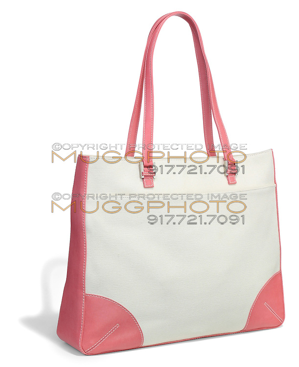 pink and white canvas bag photographed on a white background