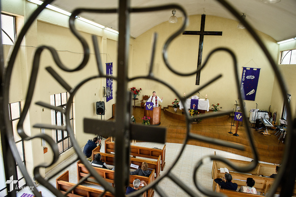 The Rev. Daniel Conrad, LCMS missionary to Mexico, is framed by a decorative Luther Seal in the church balcony as he preaches during worship at the Lutheran Church of San Pedro on Sunday, Feb. 14, 2016, in Mexico City, Mexico. LCMS Communications/Erik M. Lunsford