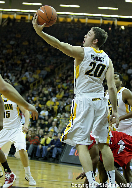 January 04 2010: Iowa Hawkeyes forward Andrew Brommer (20) pulls in a rebound during the first half of an NCAA college basketball game at Carver-Hawkeye Arena in Iowa City, Iowa on January 04, 2010. Ohio State defeated Iowa 73-68.