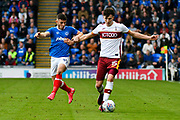 Conor Chaplin (19) of Portsmouth battles for possession with Tom Field (15) of Bradford City during the EFL Sky Bet League 1 match between Portsmouth and Bradford City at Fratton Park, Portsmouth, England on 28 October 2017. Photo by Graham Hunt.