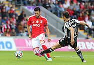 Portugal, FUNCHAL :Benfica's Greek midfielder Samaris  vies with Nacional´s Portuguese forward João Camacho during the Portuguese league football match CD Nacional vs Benfica at the Madeira stadium in Funchal on November 09, 2014.  AFP PHOTO / GREGORIO CUNHA