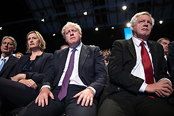 © Licensed to London News Pictures . 04/10/2017. Manchester, UK. PHILIP HAMMOND , AMBER RUDD , BORIS JOHNSON and DAVID DAVIS sit and listen as Prime Minister Theresa May delivers her keynote speech on the fourth and final day of the Conservative Party Conference at the Manchester Central Convention Centre . Photo credit: Joel Goodman/LNP