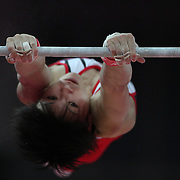 A Japanese gymnast performs his horizontal bar routine during the Men's Artistic Gymnastics podium training at North Greenwich Arena during the London 2012 Olympic games preparation at the London Olympics. London, UK. 25th July 2012. Photo Tim Clayton