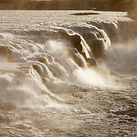 Iceland, Hvita River pours over Gullfoss waterfall at dawn on summer morning