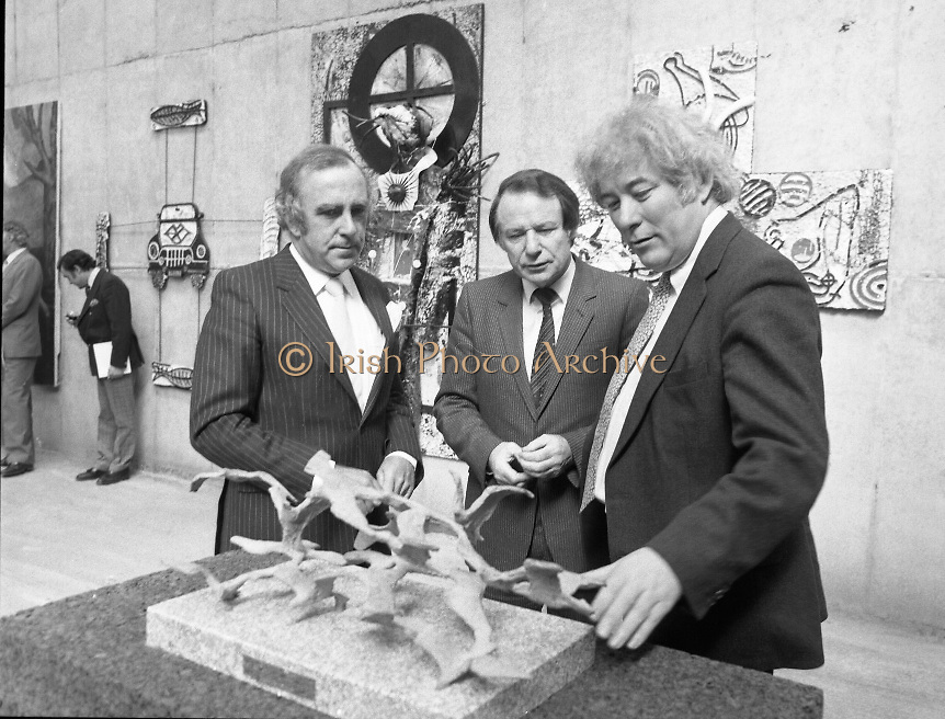 The G.P.A.awards for Emerging Artists..(Guinness Peat Aviation).1984..23.09.1984..09.23.1984..23rd September 1984..The award ceremony was held at The Royal Hibernian Academy of Arts,Gallagher Gallery,Ely Place,Dublin..Image of Mr Tony Ryan, GPA Director,The Minister for Arts and Culture,Mr Ted Nealon TD and Mr Seamus Heaney recipient of the award for Outstanding Individual Contribution to the Arts discussing the merits of a piece of sculpture..