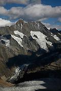 Top of Europe, Aufstieg mit der Zahnradbahn von Lauterbrunnen aufs Jungfraujoch. Aussichten auf die Bergriesen Eiger, Mönch und Jungfrau sowie auf den längsten Gletscherstrom der Alpen bietet die Jungfraubahn, die durchs Herz der Berge hindurch zur höchsten Bahnstation Europas auf 3454 Meter über Meer fährt. Die Jungfraubahn fährt ganzjährig von der Kleinen Scheidegg bis aufs Jungfraujoch und bewältigt auf der rund neun Kilometer langen Strecke annähernd 1400 Höhenmeter und etwas mehr als sieben Kilometer Tunnel. Das Jungfrau-Aletschgebiet mit der einzigartigen Pflanzen- und Tierwelt ist das erste Unesco Weltnaturerbe im ganzen Alpengebiet. .Journey to the Jungfraujoch - Top of Europe, at 3454 metres Europe's highest altitude railway station, a highlight of every visit to Switzerland. It offers a high-Alpine wonderworld of ice, snow and rock, which can be marvelled at from vantage terraces, the Aletsch Glacier or in the Ice Palace.On clear days, views extend as far as the Vosges mountains in France and Germany's Black Forest. The train journey to the Jungfraujoch through the rock of the Eiger and Mönch is an incredible experience.Visitors can enjoy stunning views from two intermediate stations, the Eigerwand (Eiger Wall) and Eismeer (Sea of Ice).  © Romano P. Riedo