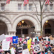 The Women's March on Washington passed by Trump International Hotel, where an anticipated 200,000 people turned into an estimated 500,000 to 1 million people, on Saturday, January 21, 2017.  John Boal Photography