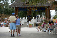 Residents watch as a band performs in the middle of the Lake Sumter Landing Market Square at the retirement community of The Villages, Fla., Wednesday, Sept. 25, 2013.(AP Photo/Phelan M. Ebenhack)