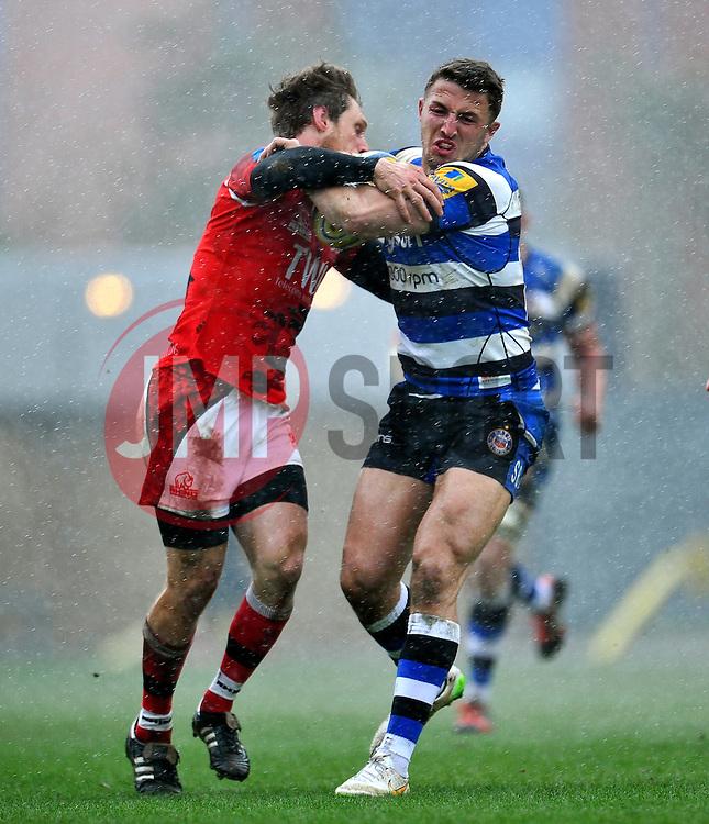 Sam Burgess of Bath Rugby is tackled - Photo mandatory by-line: Patrick Khachfe/JMP - Mobile: 07966 386802 29/03/2015 - SPORT - RUGBY UNION - Oxford - Kassam Stadium - London Welsh v Bath Rugby - Aviva Premiership