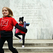 Brooklyn Buckner, 7, and her friend Ada Scout Johnson, 6, both of Albany, jump down the Capitol steps. Thousands of educators and their supporters from all over the state gather at the Oregon State Capitol to rally for adequate school funding. A select group of teachers and staff members spoke to Gov. Kate Brown about their experiences, and shared with her the challenges of being a teacher today.<br /><br />Photography by Thomas Patterson.