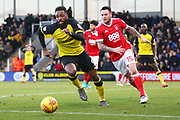 Burton Albion's Darren Bent and Nottingham Forest's Lee Tomlin during the EFL Sky Bet Championship match between Burton Albion and Nottingham Forest at the Pirelli Stadium, Burton upon Trent, England on 17 February 2018. Picture by John Potts.