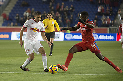 March 1, 2018 - Harrison, New Jersey, United States - New York Red Bulls midfielder SEAN DAVIS (27) fights for the ball against Club Deportivo Olimpia Defender JOHNNY PALACIOS (30) during the CONCACAF Champions league match at Red Bull Arena in Harrison, NJ.  NY Red Bulls defeat CD Olimpia 2-0  (Credit Image: © Mark Smith via ZUMA Wire)