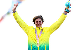 Australia's Katrin Garfoot celebrates with her gold medal won in the Women's Individual Time Trial during the Women's Individual Time Trial at Currumbin Beachfront during day six of the 2018 Commonwealth Games in the Gold Coast, Australia.