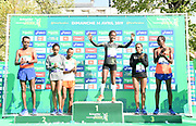 Men's winner Abrha Milaw (ETH)  and Gelete Burka (ETH), center, poses with second-place finishers Asefa Mengistu (ETH) and Azmera Gebru (ETH) and third-place finishers Paul Lonyangata (KEN) and Azmera Abreha (ETH) at the 43rd Paris Marathon in IAAF Gold Label road race in Paris, Sunday, April 14, 2019. (Jiro Mochizuki/Image of Sport)