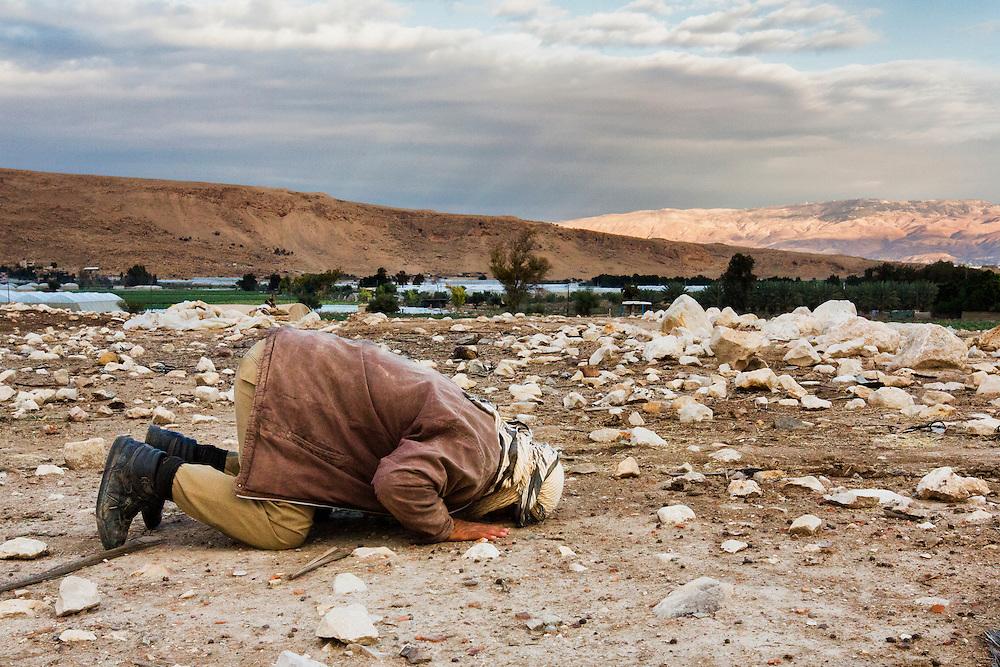 A man of faith prays on the bare ground. Dec. 10, 2013. West Bank, Palestinian Territories. (Photo by Gabriel Romero/Alexia Foundation ©2014)