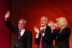 © Licensed to London News Pictures. 24/09/2018. Liverpool, UK. Shadow Chancellor John McDonnell MP (L), Leader of the Labour Party Jeremy Corbyn MP (C) and General Secretary of the Labour Party Jennie Formby (R) celebrate after the Shadow Chancellor delivered his speech to the Labour Party Conference. Photo credit: Rob Pinney/LNP