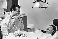 Dr. Michael Glick (left) chats with a patient in 1989 at the Infectious Disease Clinic at Temple University in Philadelphia, Pennsylvania. The Infectious Disease Clinic at Temple University, was established in 1988 by Dr. Glick to treat people with HIV from throughout the region. (Photo by William Thomas Cain/Cain Images)