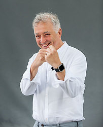 Pictured: Frank Cottrell Boyce, children's author and writer of the 2012 Olympics opening ceremony, at the Book Festival.<br /> <br /> © Dave Johnston / EEm