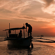MANILA (Philippines). 2009. Boat on Manila Bay at sunset.