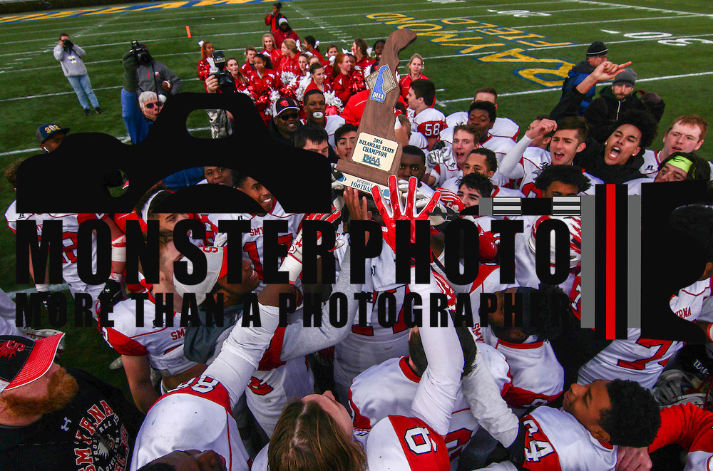 Smyrna (12-0) players celebrate the championship trophy after winning their second straight DIAA division one Football Championship defeating Top-seeded Middletown (11-1) 36-14 Saturday, Dec. 03, 2016 at Delaware Stadium in Newark.