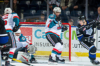 KELOWNA, CANADA - JANUARY 25: Kaedan Korczak #6 blocks the net as James Porter #1 of the Kelowna Rockets makes a save against the Victoria Royals  on January 25, 2019 at Prospera Place in Kelowna, British Columbia, Canada.  (Photo by Marissa Baecker/Shoot the Breeze)