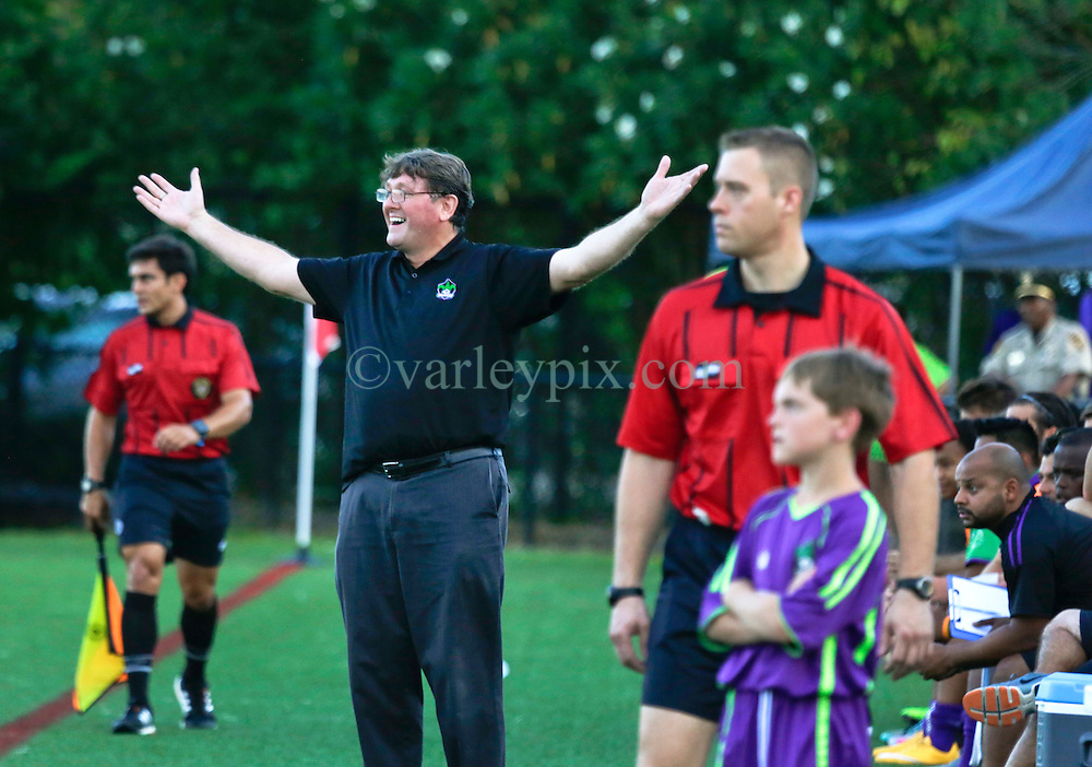 27 June 2015. New Orleans, Louisiana.<br /> National Premier Soccer League. NPSL. <br /> Jesters 1- Georgia Revolution 5.<br /> Jesters head coach Kenny Farrell contests one of many dubious referees decisions as the New Orleans Jesters lose 1-5 to the Georgia Revolution in a lightning delayed game at home in the Pan American Stadium. <br /> Photo&copy;; Charlie Varley/varleypix.com