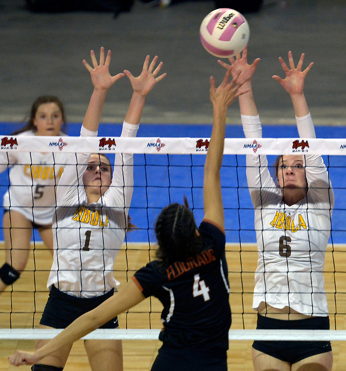 gbs110917h/SPORTS -- Eldorado's Catessa Duran, 4, hits against the defense of  Cibola's Kylee Winner, 1, and Lauren Montoya, 6,  during the State Volleyball Championships at the Santa Ana Star Center on Thursday, November 9, 2017. (Greg Sorber/Albuquerque Journal)