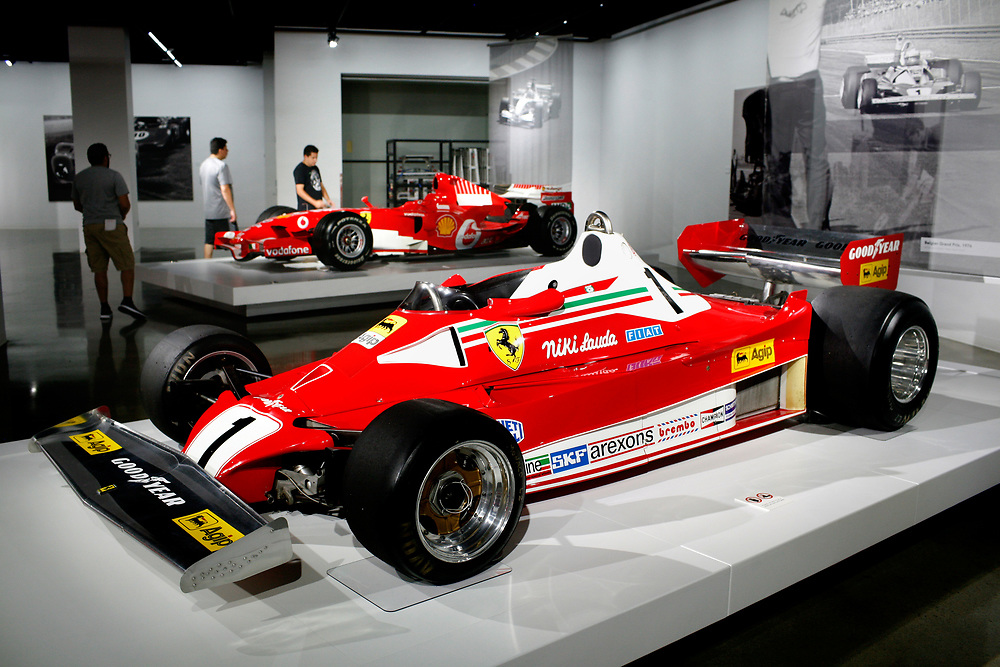 "Ferrari Formula One race cars -- a 1976 driven by Niki Lauda, foreground, and the 2001 version by Michael Schumacher -- are part of the exhibit ""Seeing Red: 70 Years of Ferrari"" at the Petersen Automotive Museum in Los Angeles on June 22, 2017. Founded in 1994. the museum underwent a $125 million renovation and reopened in 2015 to showcase 100 vehicles in 25 galleries. (Photo by Geoff Hansen)"