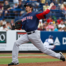 March 6, 2011; Port St. Lucie, FL, USA; Boston Red Sox relief pitcher Michael Bowden (64) during a spring training exhibition game against the New York Mets at Digital Domain Park. The Mets defeated the Red Sox 6-5.  Mandatory Credit: Derick E. Hingle
