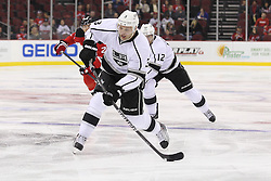Oct 13; Newark, NJ, USA; Los Angeles Kings defenseman Jack Johnson (3) takes a shot during the first period of their game against the New Jersey Devils at the Prudential Center.